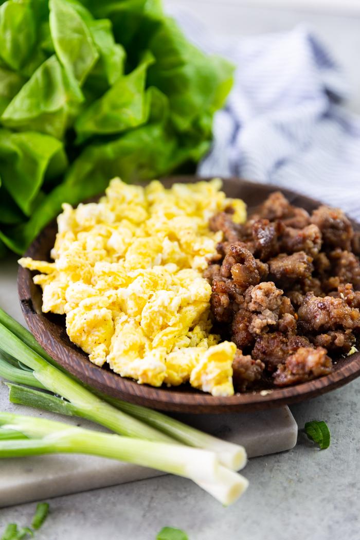 ingredients in a brown bowl for breakfast lettuce wraps