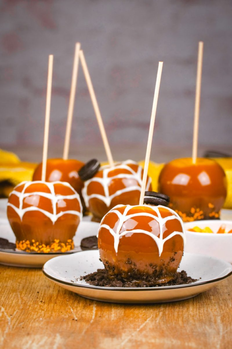 A plate with a Halloween decorated caramel apple