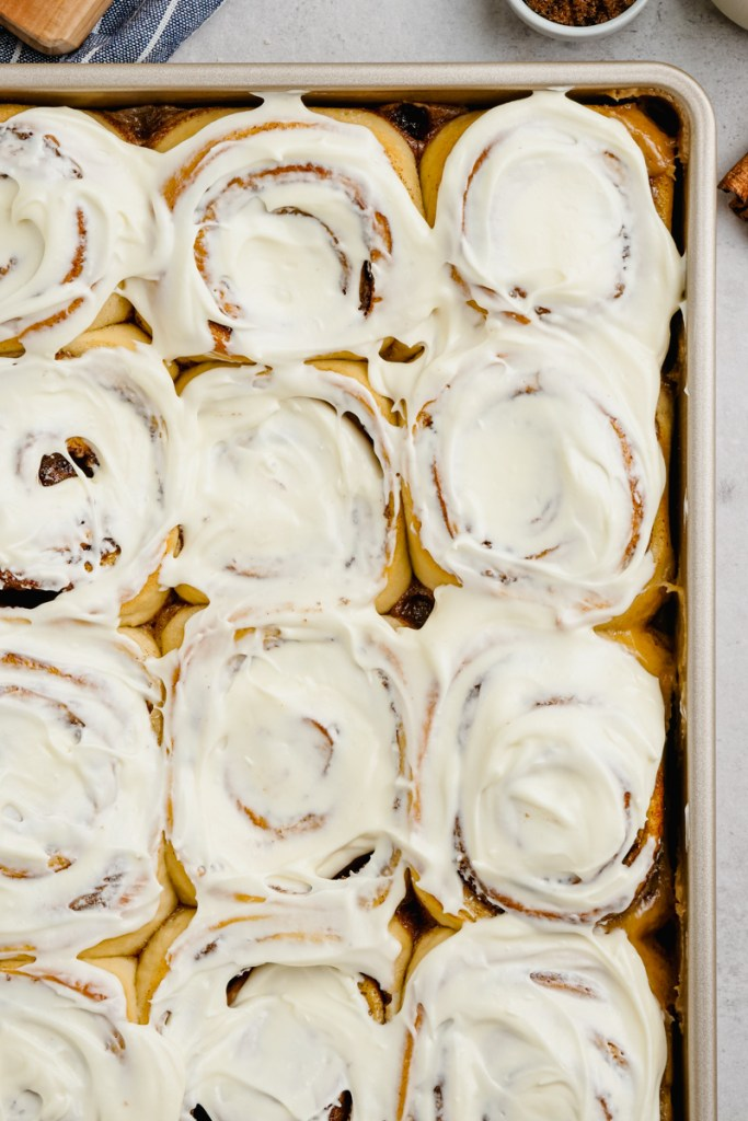 Cinnamon rolls that are frosted with a cream cheese frosting.