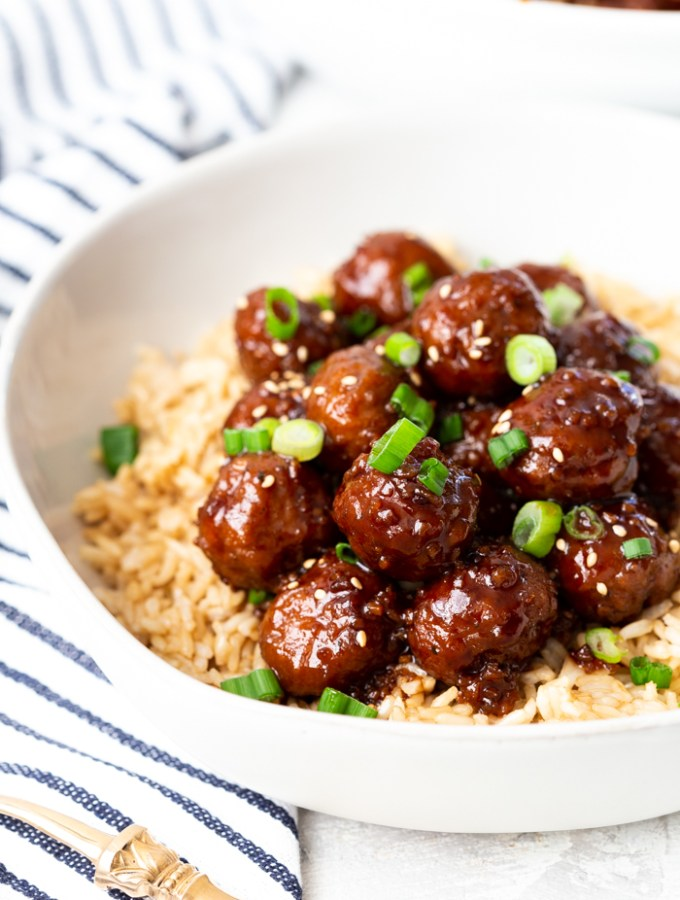 mongolian beef meatballs with most of the white bowl showing