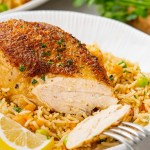 instant pot chicken and rice in white dish with fork