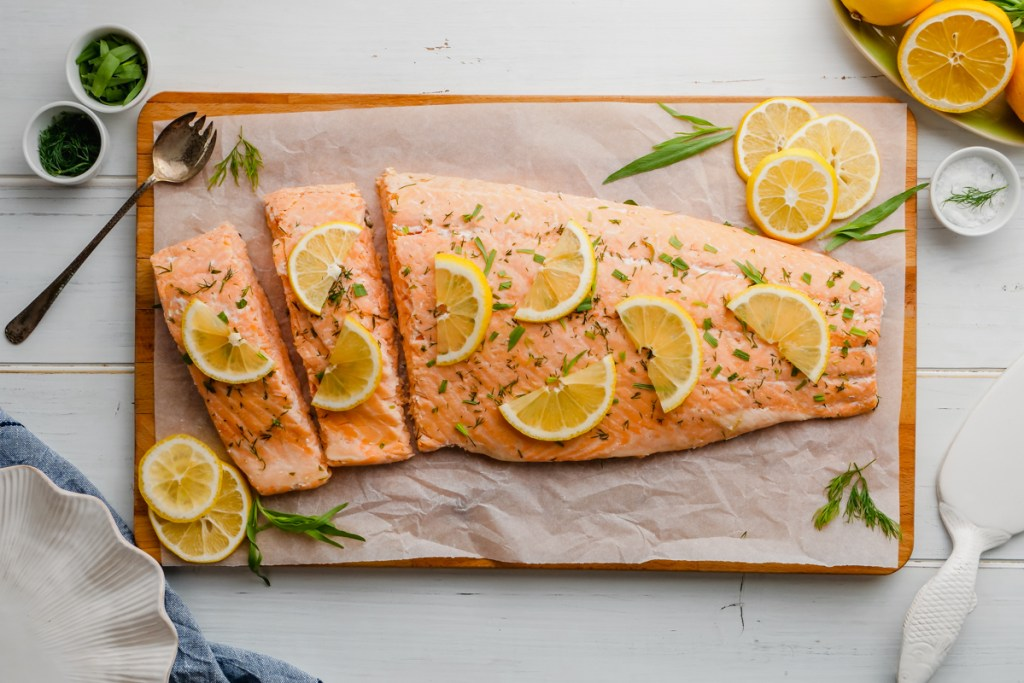 Poached salmon on a cutting board