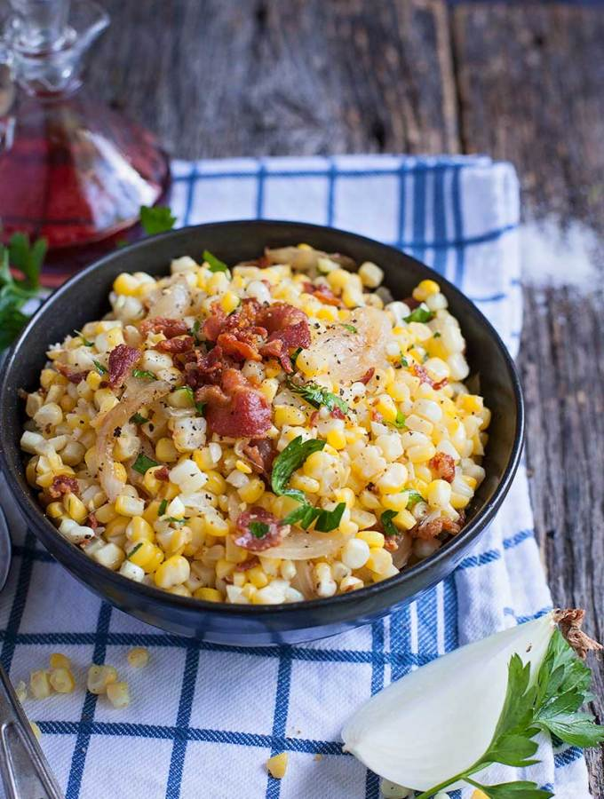 Roasted corn with bacon and caramelized onions are the best of simple flavors with a big impact. It's sure to be a side dish that even the corn reluctant eaters will enjoy!