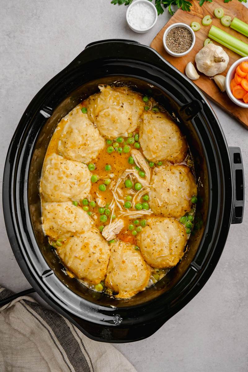 A slow cooker with chicken and dumplings