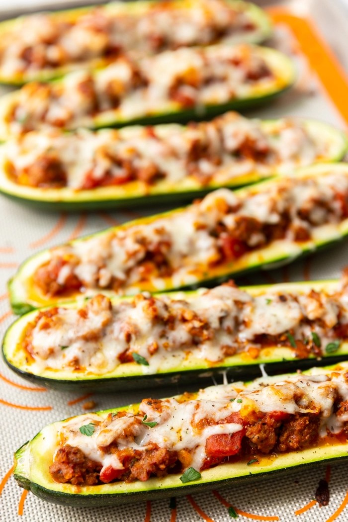 a tray full of beef stuffed zucchini boats