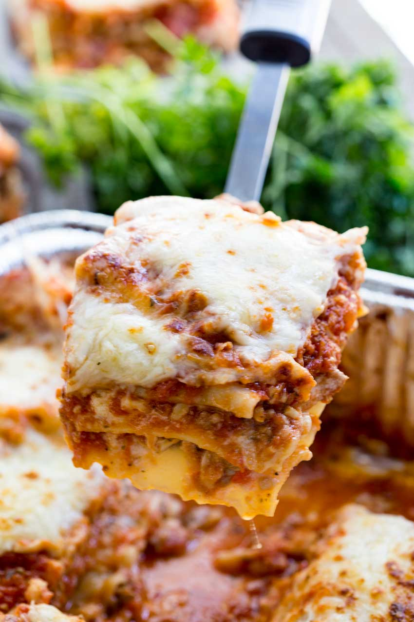 A scoop of traditional meat sauce lasagna with mushrooms
