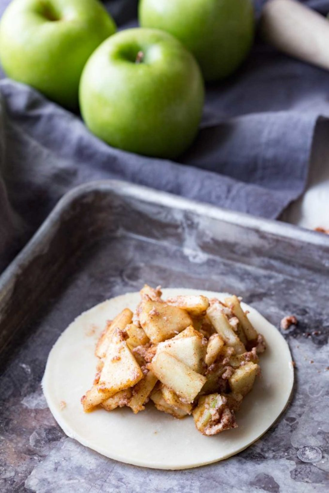 Add filling to pie crust for mummy apple hand pies