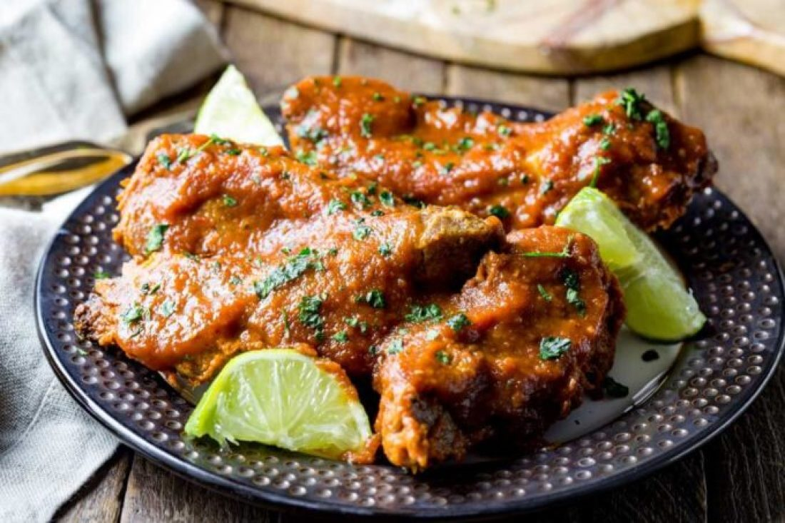 Delicious ribs cooked in slow cooker and smothered in pineapple chipotle sauce