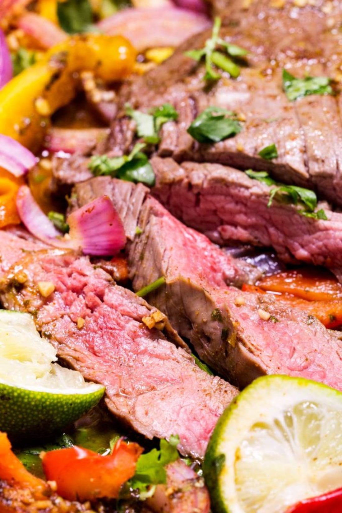 Tender flavorful beef and fajita fixings, this is a one sheet pan meal that is killer!