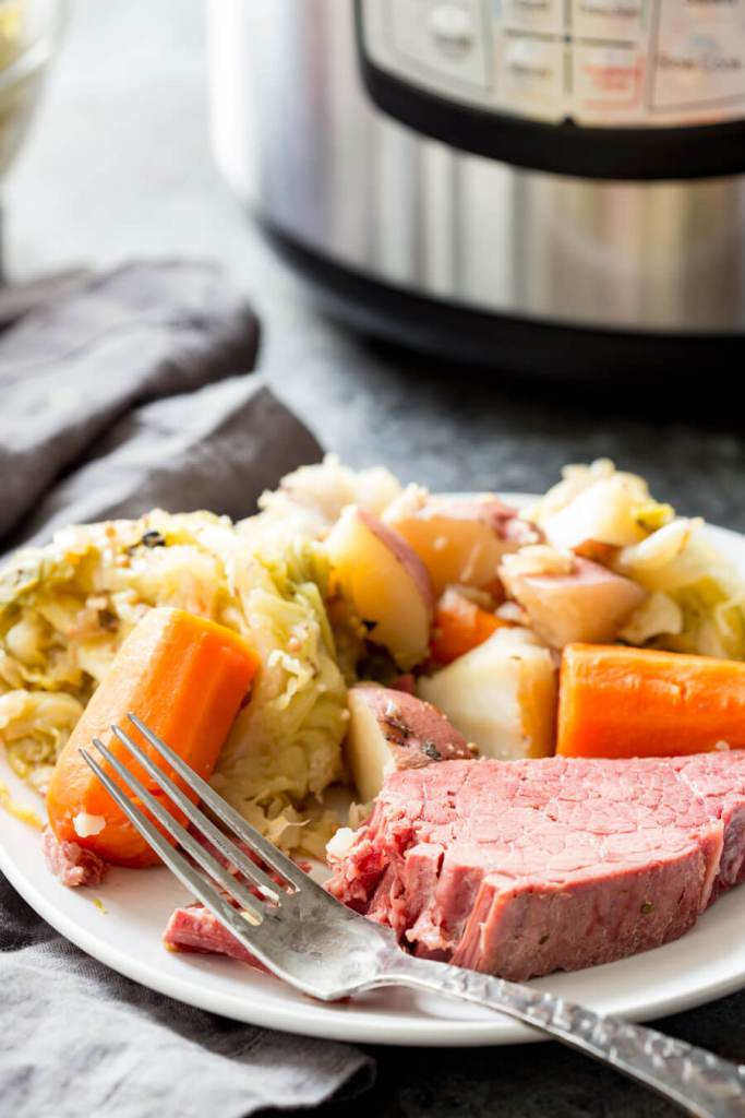 Corned Beef, a tender, flavorful, and totally fun recipe for Corned Beef and Cabbage, cooked in an instant pot, or slow cooker. You only need about 5 minutes prep time to get everything ready for a delicious Irish meal of Corn Beef and Cabbage.