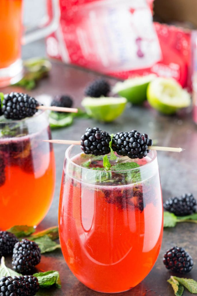 Mocktail with black cherry dragonfruit lime black berry and mint