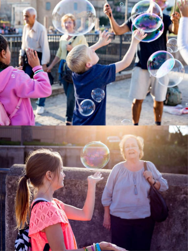 Kids chasing bubbles in Rome