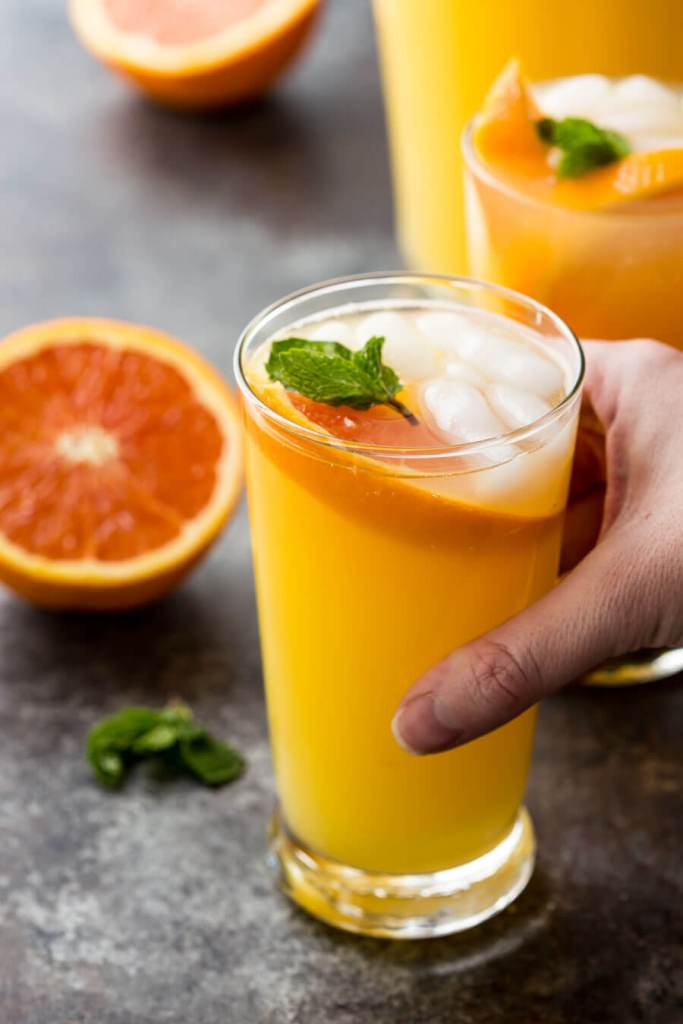 Fresh and refreshing mango orange mojito virgin drink