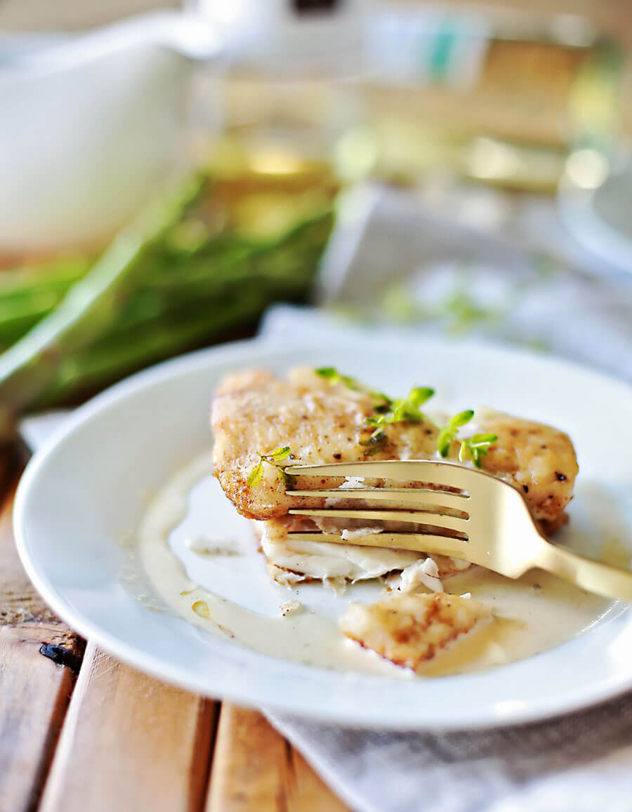 Haddock recipe with white wine sauce: Flaky haddock pan fried, and served with a browned butter white wine sauce. Amazingly flaky fish, with a gourmet flavor, prepared in 20 minutes or less. This simple but elegant meal is sure to be a hit!