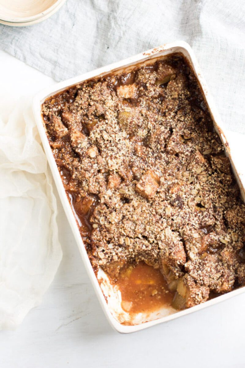 Insanely Delicious Apple Pear Crisp with an oat, almond, and pumpkin seed topping. Gluten free and yummy!