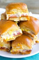 Hawaiian Pizza Sliders are an easy appetizer for your next party that's a sure fire hit! These little bites of deliciousness taste just like your favorite pizza and are ready twice as fast as your local pizzeria!