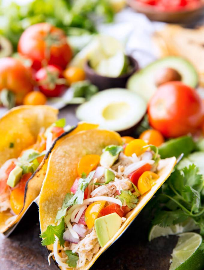 Honey Lime Chicken Tacos are cooked in the slow cooker, shredded, and used in tacos, burritos, nachos, etc. It is flavor packed and super delicious.
