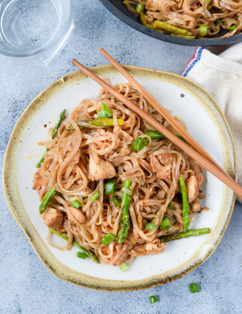 Chicken Asparagus Stir Fry Rice Noodles is a quick stir fry recipe with bursting Asian flavors. All you will need is one pan and less than 30 minutes to make a delicious weeknight dinner. While Chicken and asparagus works as a wonderful combination, you add any vegetable of your choice.