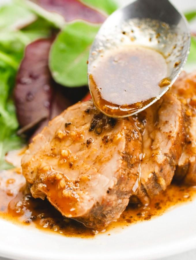 A delicious pork tenderloin, sauces with a tropical sauce
