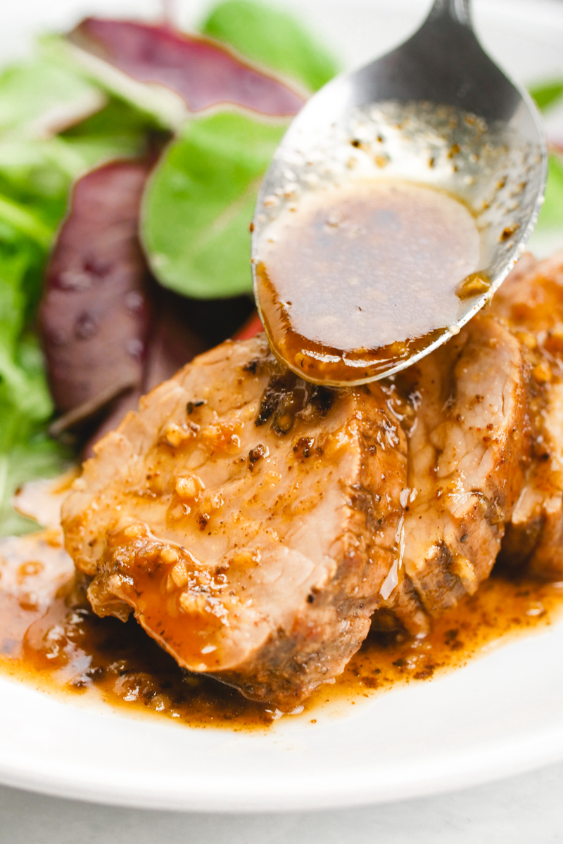 A delicious pork tenderloin, sauces with a tropical sauce