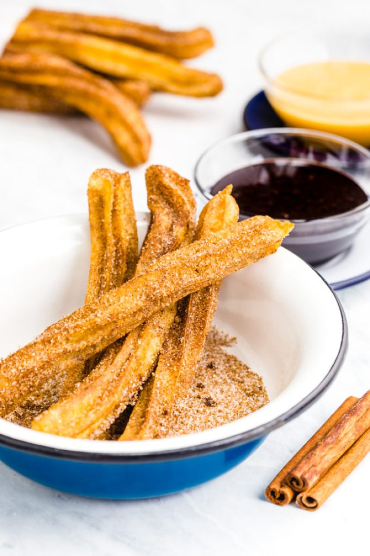 Churros- fried dough dipped in cinnamon and sugar and paired with caramel and chocolate dipping sauces