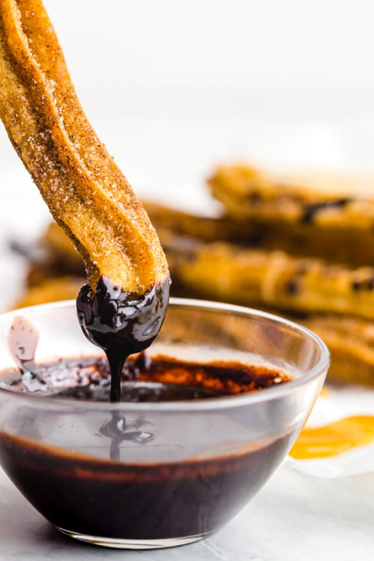 Easy to make churros dipped in a chocolate ganache sauce that is amazing