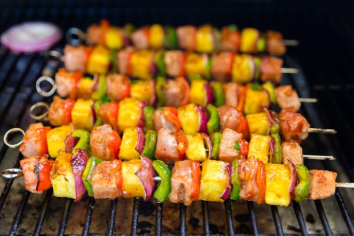 Cooking sticky bbq pork kabobs on the grill, 6 kabobs cooking