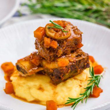 Braised short ribs, a great dinner option, served over polenta