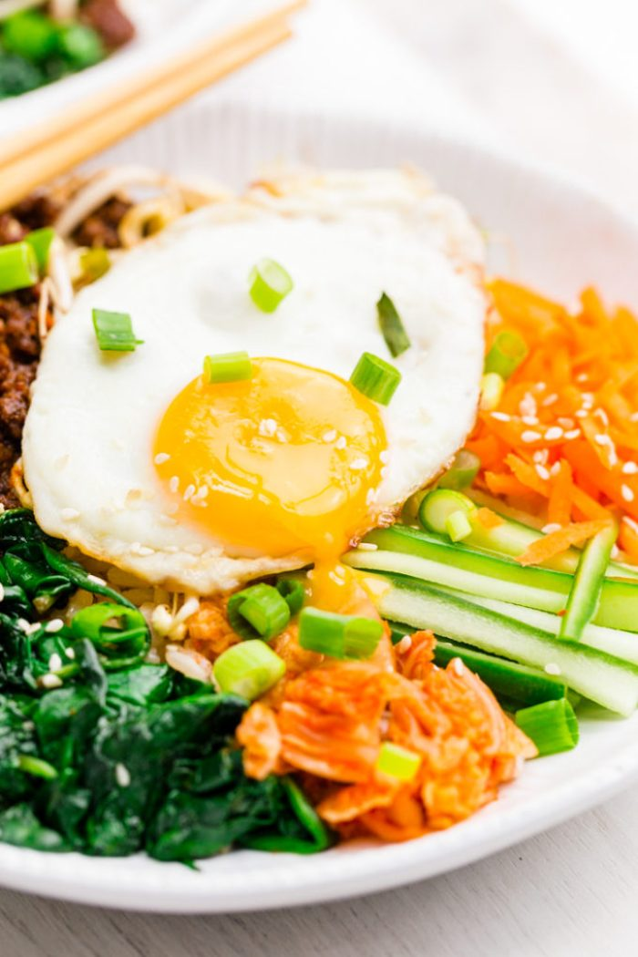 White bowl filled with bibimbap