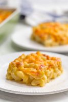 Mac and cheese casserole on a white plate
