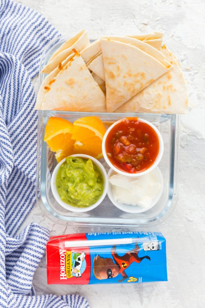 Quesadilla triangles, guacamole, salsa, and sour cream, oranges