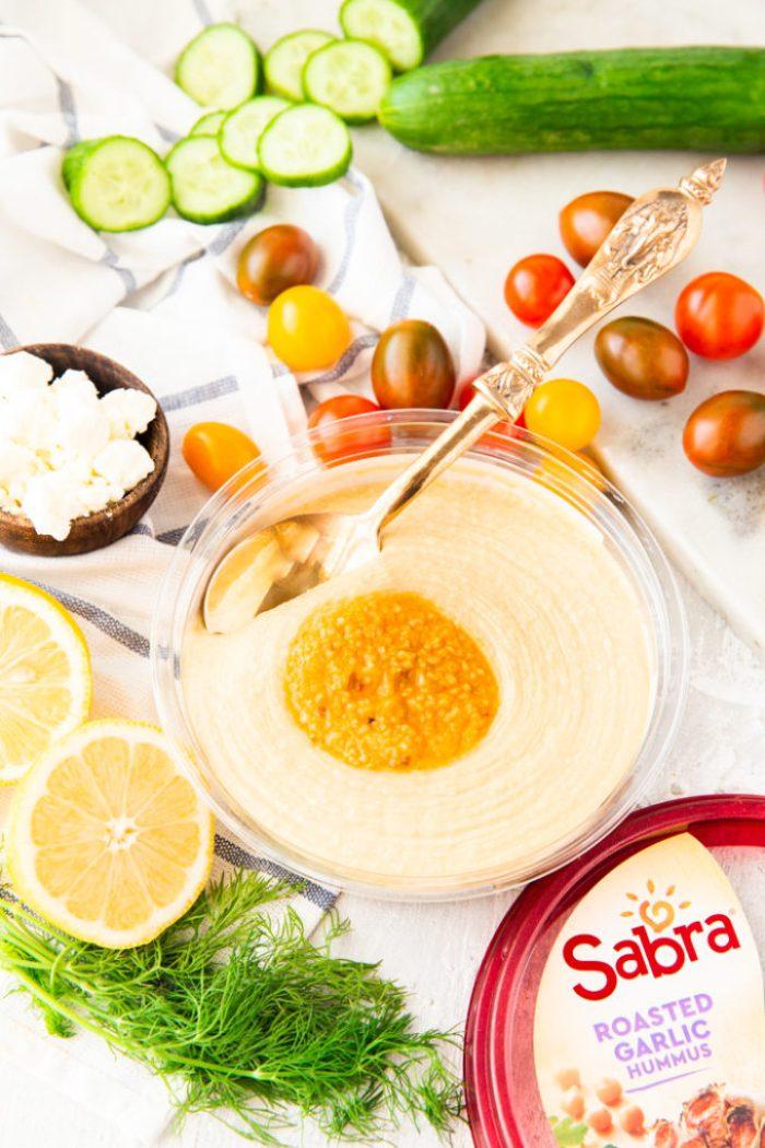 Greek chicken power bowl ingredients with hummus