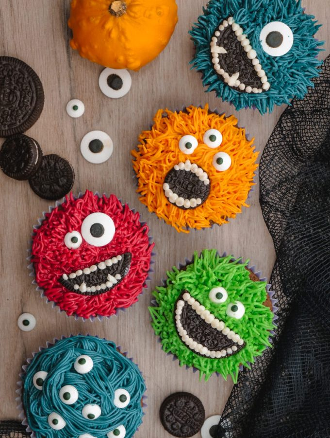 Monster Halloween Cupcakes- Grass icing tip, colored frosting, eye balls, and OREO cookies
