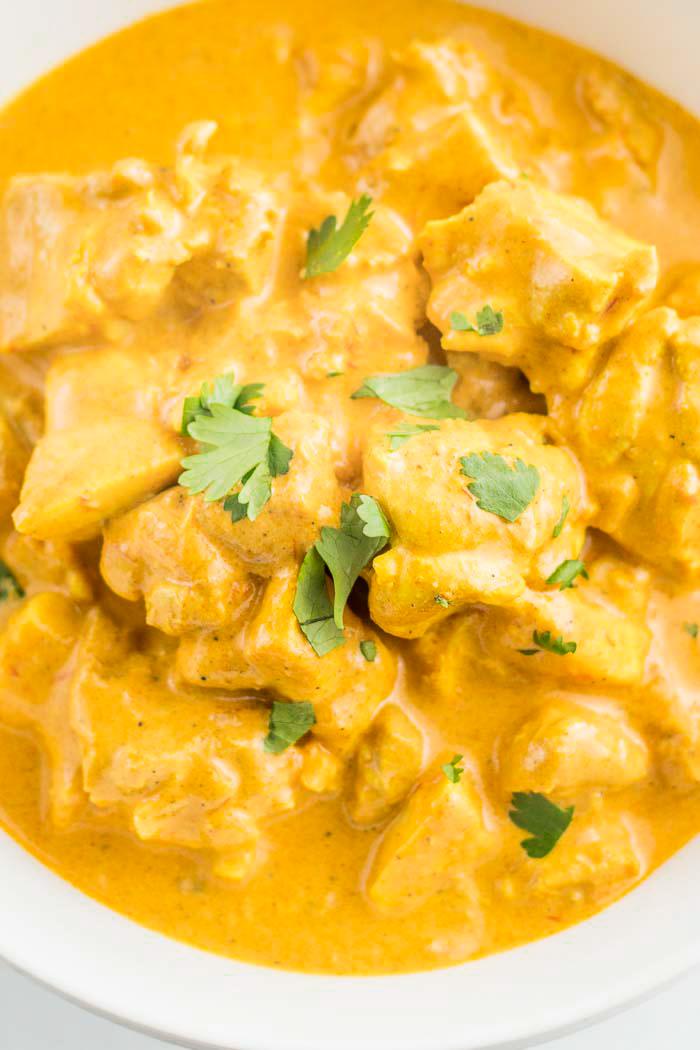 Indian butter chicken, garnished with fresh cilantro