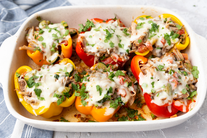 Pork stuffed peppers, topped with cilantro and sweet and smokey pork
