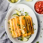 A plate of breakfast taquitos with garnish