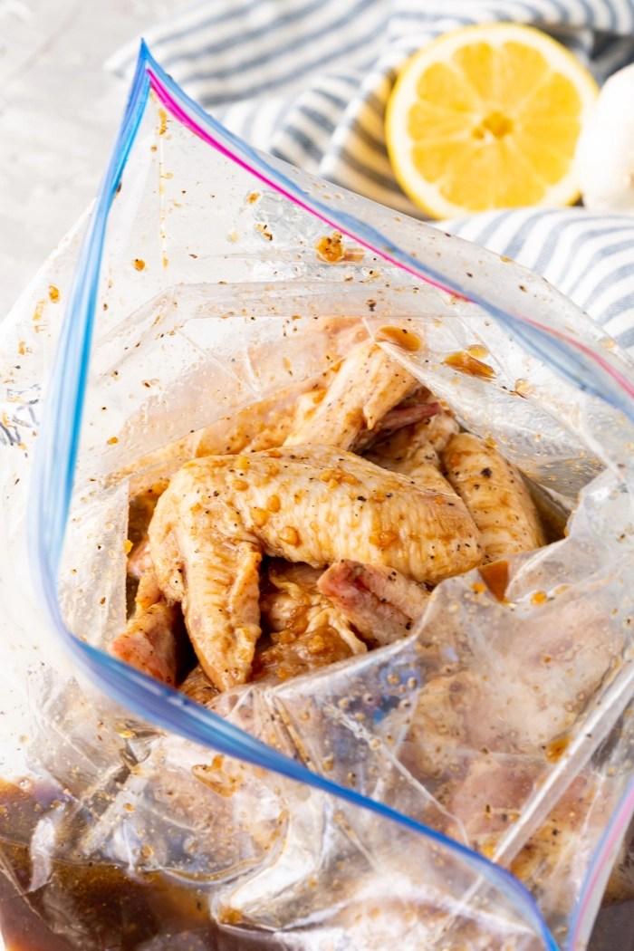Chicken wings in a marinade in a zip top bag