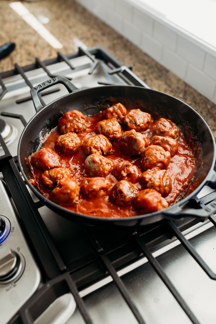A skillet full of meatballs and manwich sloppy joe sauce