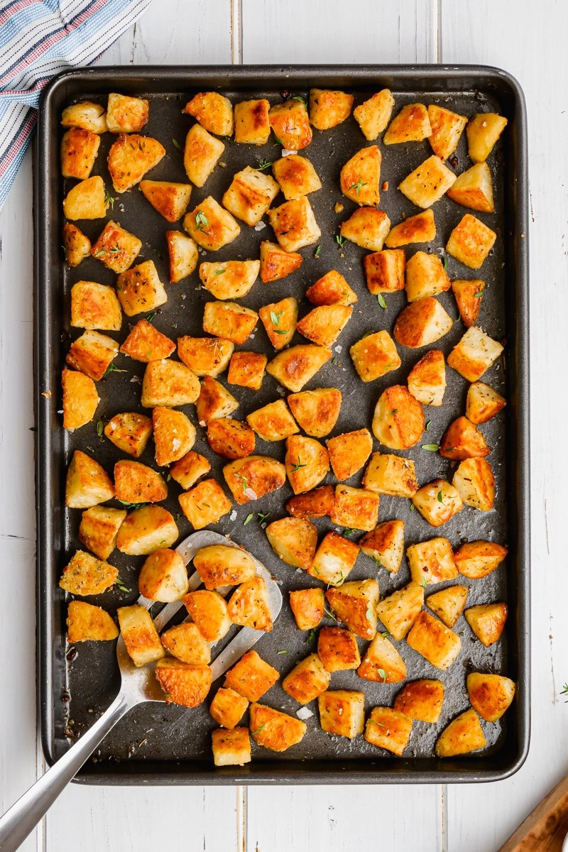 A baking sheet loaded with crispy baked potatoes