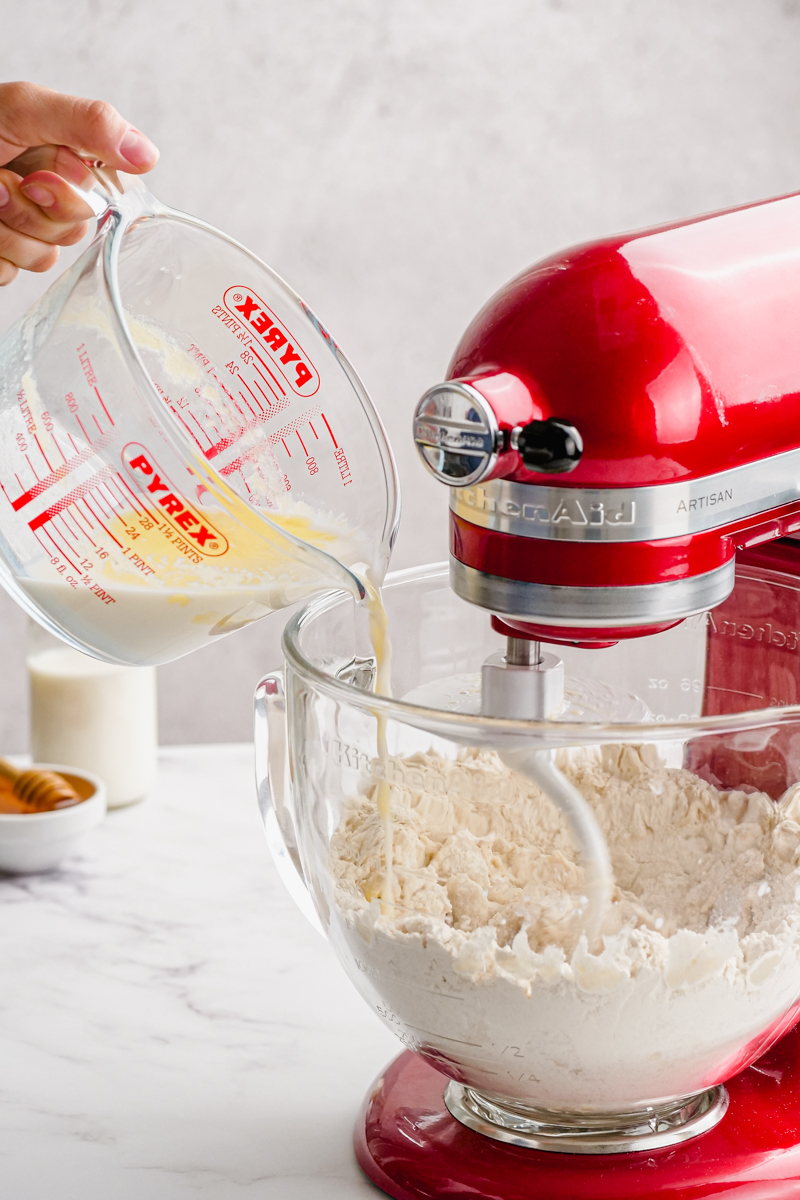 Combining wet and dry ingredients in a stand mixer.