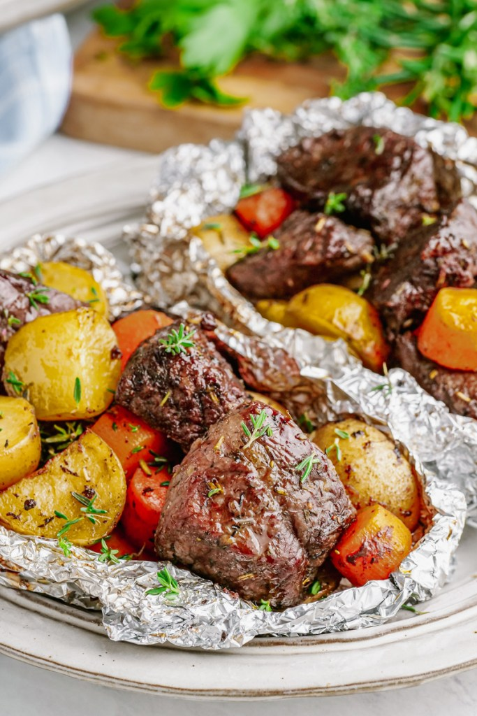 Steak foil packs with carrots and potatoes.