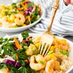 Caribbean shrimp on a plate with coconut rice and chard salad