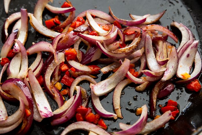 Cooking peppers and onions