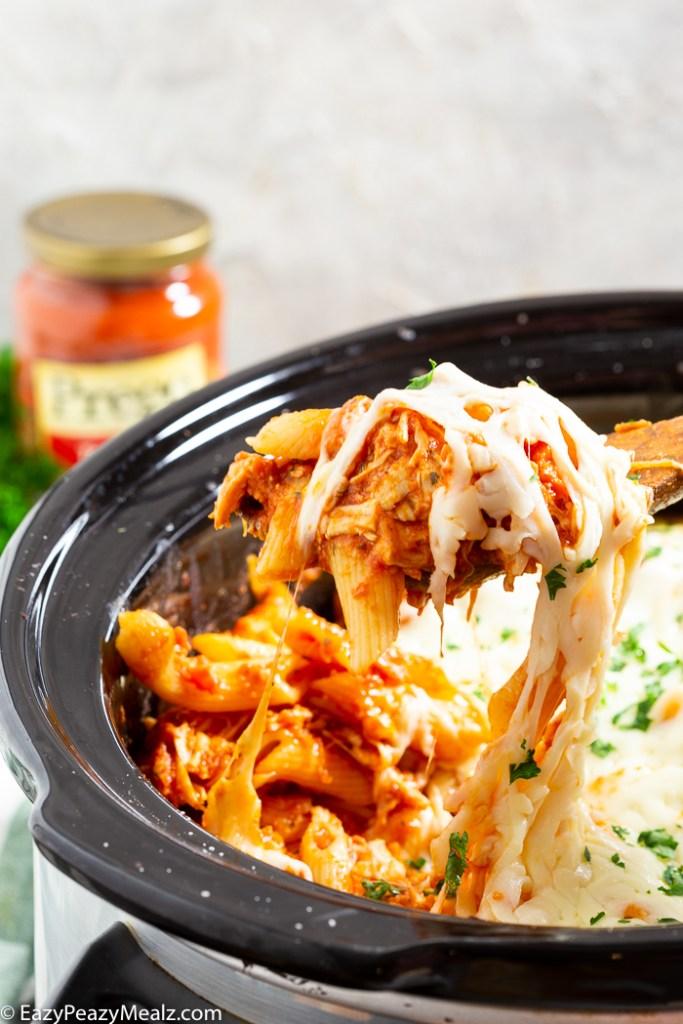 Garnish and serve chicken parmesan casserole