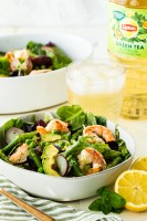 A bowl of spring salad with citrus shrimp