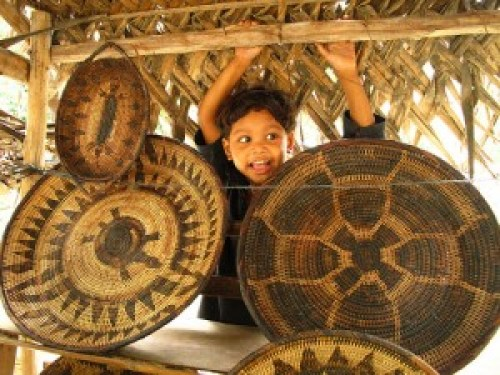 Mangyan Child with Nito Basketry