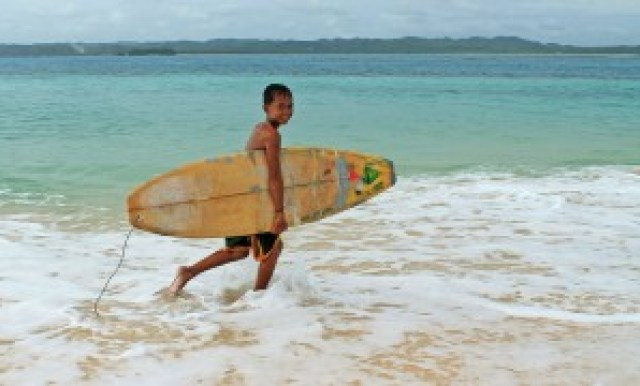 Young Surfer at Dakô Island
