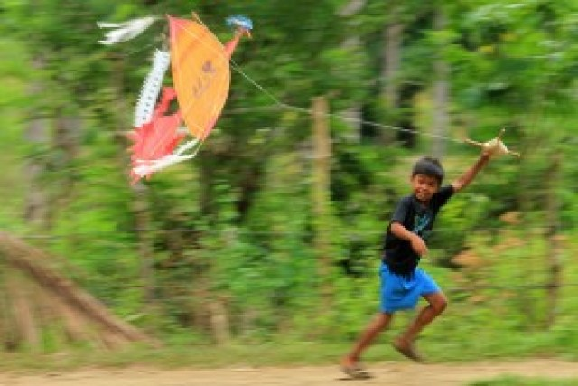 Pala'wan Boy Playing Kite