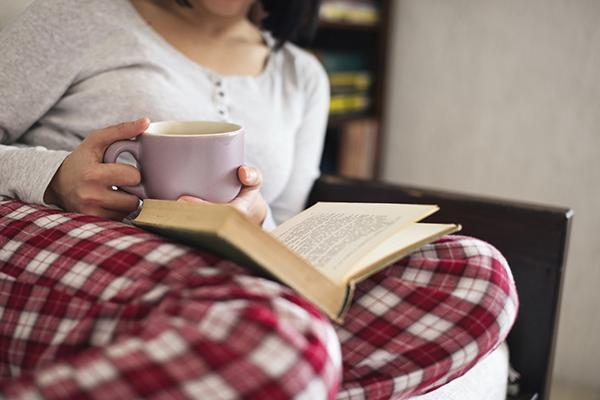 Woman In Pajamas Reading