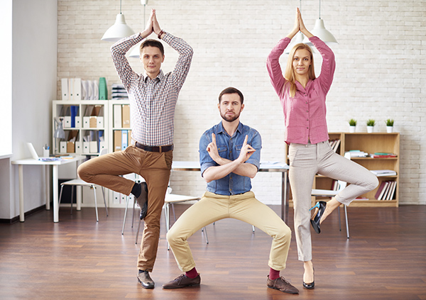 Young Office Workers Doing Yoga